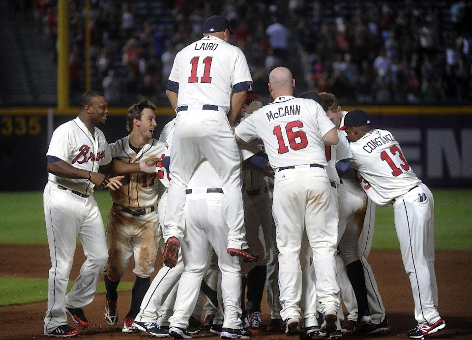 B.J. Upton lifts Braves past Marlins in 11th, 5-4