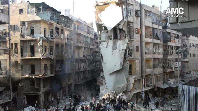 In this Tuesday, Dec. 17, 2013 citizen journalism image provided by Aleppo Media Center, AMC, and released Wednesday, Dec. 18, 2013, which has been authenticated based on its contents and other AP reporting, Syrians inspect the rubble of damaged buildings following a Syrian government airstrike in Aleppo, Syria. Syrian warplanes dumped explosive-laden barrel bombs over opposition-held parts of the northern city of Aleppo on Wednesday, the fourth day of a relentless offensive to drive rebels out of the contested city, activists said. The country's conflict, now in its third year, appears to have escalated in recent weeks as both sides maneuver ahead of next month's planned peace talks and ignore calls for a cease-fire. (AP Photo/Aleppo Media Center, AMC)