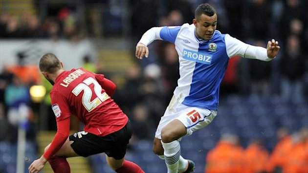 Blackburn Rovers's Josh King (right) is tackled by Nottingham Forest's Henri Lansbury (PA Photos)