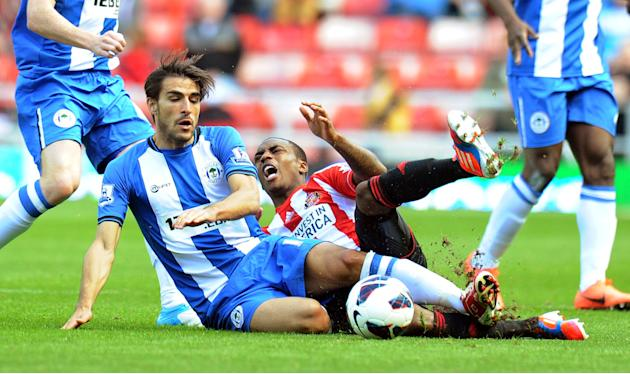 Wigan's Jordi Gomez, left, was sent off in the second half