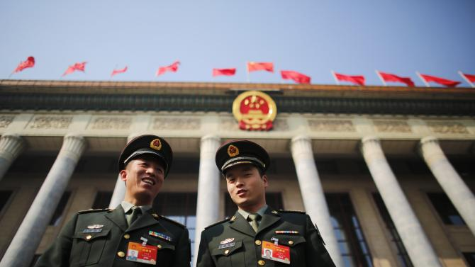 Military delegates leave the Great Hall of the People after the first annual full session of the National People's Congress, the country's parliament, in Beijing