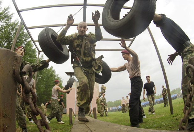 Servicemen from the Interior Ministry's special unit run through an obstacle course as they take part in a test near the village of Gorany