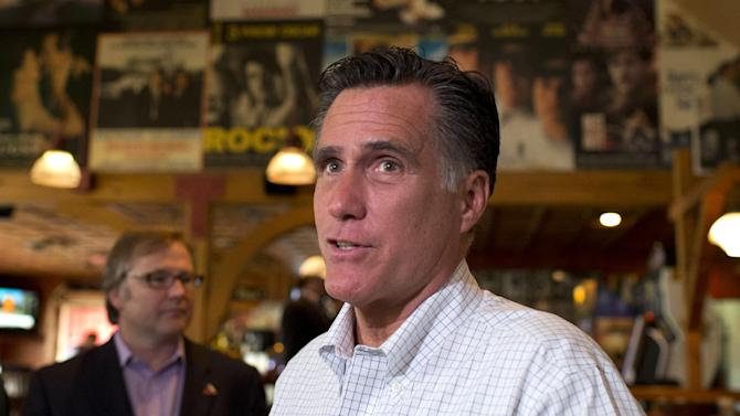 Republican presidential candidate, former Massachusetts Gov. Mitt Romney speaks with reporters after stopping at Lui-Lui Restaurant on Wednesday, Sept. 5, 2012 in West Lebanon, N.H.  (AP Photo/Evan Vucci)