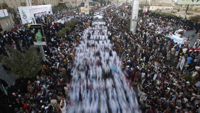 Yemeni pro-democracy protesters march during a parade marking the second anniversary of the revolution in Sanaa, Yemen, Monday, Feb. 11, 2013. The 2011 Yemeni Revolution was as an extension of the broader Arab Spring which has toppled four authoritarian leaders to date. Yemenis were able to create a unique revolution, their struggle came peacefully, unarmed, and lead by women and youth. (AP Photo/Hani Mohammed)