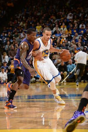 Curry leads Warriors past Suns 115-86