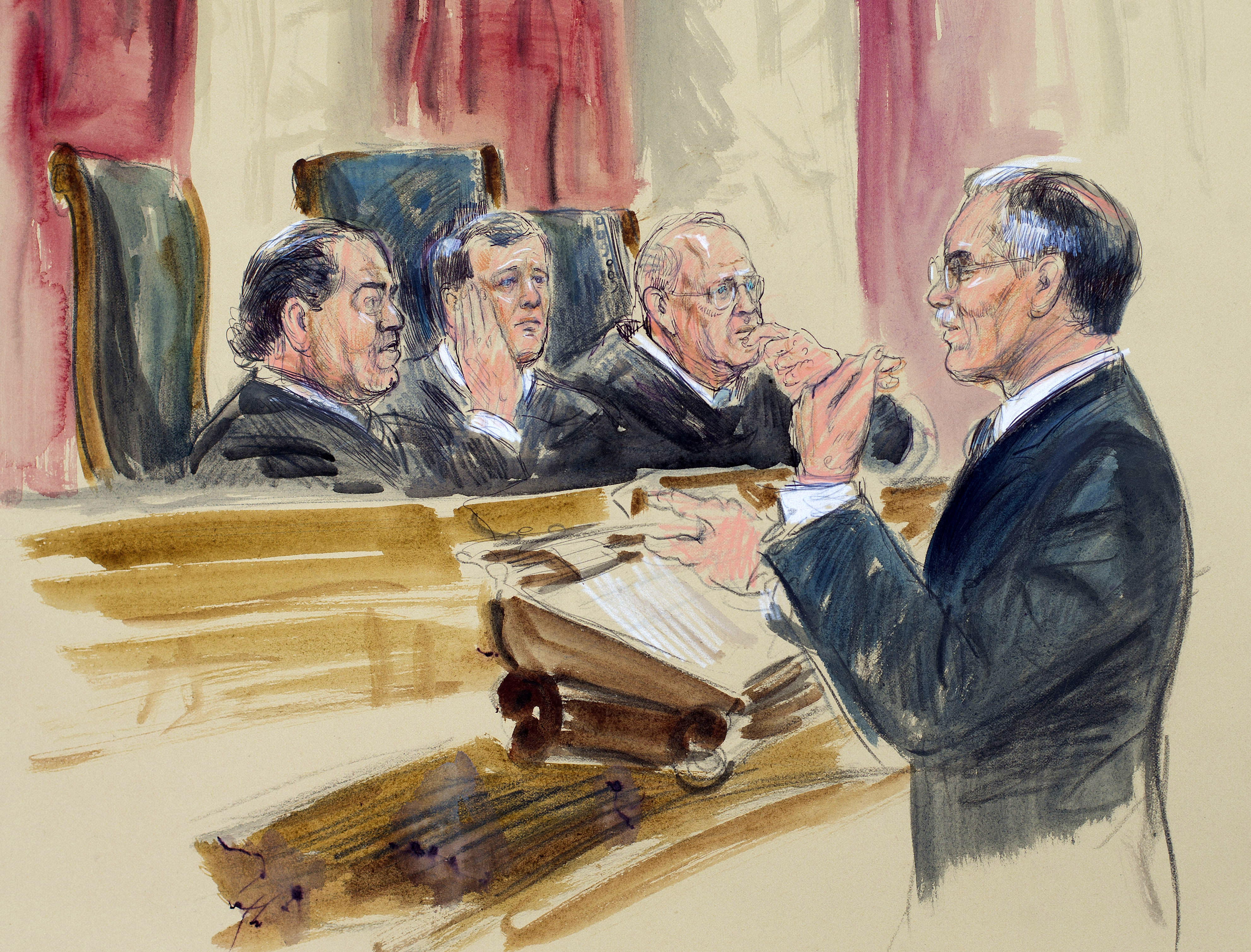 Justices sharply divided over health care law subsidies