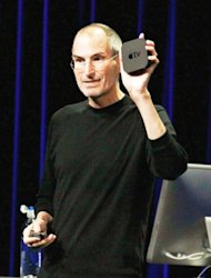The late Steve Jobs holds an Apple TV device at an event in San Francisco, California in 2010. Apple sold 2.8 million Apple TV devices last year and nearly that many in the first few months of this year, according to current CEO Tim Cook