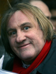 FILE- This April 14, 2010 file photo shows French actor Gerard Depardieu posing for a photograph as his arrives for the inauguration of U.S. fashion designer Ralph Lauren's new shop in Paris. Gerard Depardieu, the French actor who has been sparring with his native country over taxes, has been granted Russian citizenship. A brief announcement on the Kremlin website said President Vladimir Putin signed the citizenship grant on Thursday Jan. 3, 2013. (AP Photo/Jacques Brinon, File)