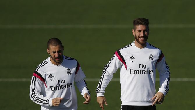 "Real Madrid's Benzema and Ramos attend a training session on the eve of their Spanish first division ""Clasico"" soccer match against Barcelona in Madrid"