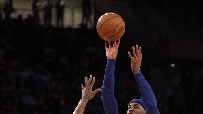 New York Knicks' Carmelo Anthony (7) shoots over Miami Heat's Chris Bosh during the first half of Game 4 of an NBA basketball first-round playoff series at Madison Square Garden, Sunday, May 6, 2012, in New York. (AP Photo/Frank Franklin II)