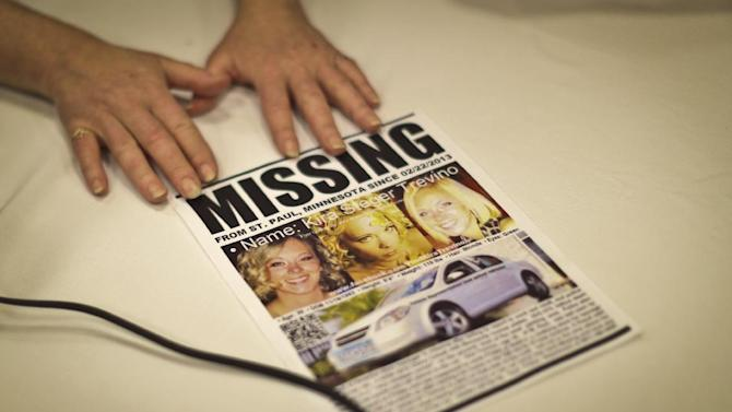 In this photo taken Wednesday, Feb. 27, 2013, Marcie Steger puts her hands on her daughter Kira Tevino's missing person poster as she speaks with family at their hotel in Bloomington, Minn. Trevino didn't show up for work at the Mall of America on Saturday, and her car was found in the mall parking lot that day. Prosecutors on Thursday charged Jeffery Dale Trevino with murdering his missing wife, after investigators found blood traces throughout the couple's St. Paul home. Authorities have not found Kira Trevino's body, but they believe she's dead. (AP Photo/The Star Tribune, Renee Jones Schneider)