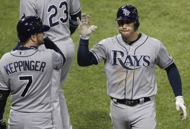 Tampa Bay Rays&#39; Evan Longoria, right, celebrates with Jeff Keppinger after hitting a solo home run against the Chicago White Sox during the ninth inning of a baseball game in Chicago, Thursday, Sept. 27, 2012. The Rays won 3-2. (AP Photo/Nam Y. Huh)