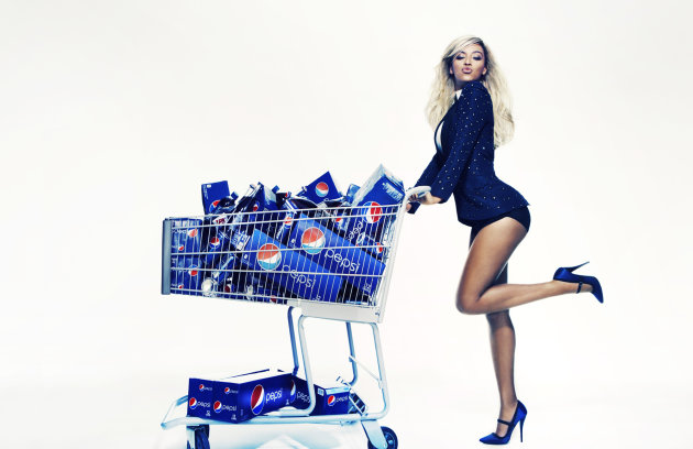 This Oct. 23, 2012 publicity photo provided by Pepsi shows Beyonce during a Pepsi Print photo shoot at Canoe Studios in New York. This image will appear as life-size standees in stores starting first quarter 2013, as an extension of the brands Live For Now campaign. Through a photo contest, 100 fans will join Beyonce onstage during the singers halftime show performance at the 2013 Super Bowl on Feb. 3, 2013, at the Mercedes-Benz Superdome in New Orleans. (AP Photo/Pepsi, Patrick Demarchelier)