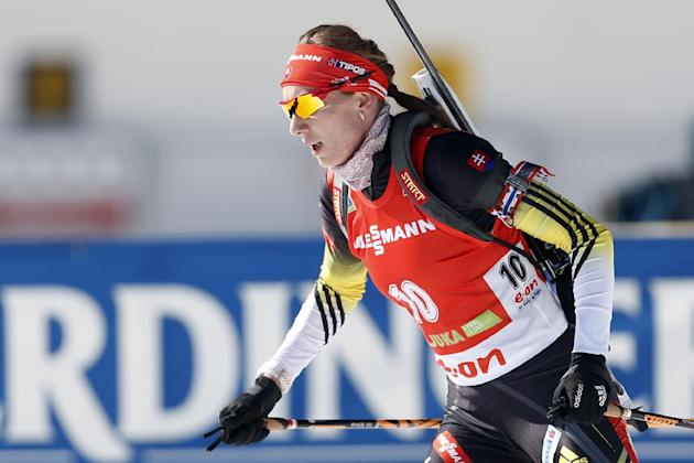 Slovakia's Anastasiya Kuzmina competes in the women's 12.5km mass start at the biathlon World Cup competition in Pokljuka, Slovenia, Sunday, March 9, 2014