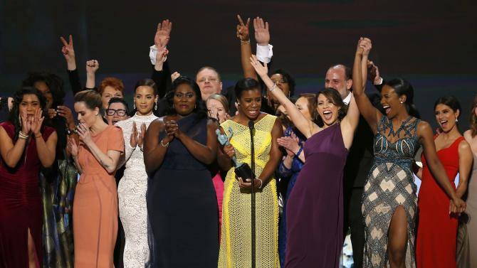 "Uzo Aduba of the Netflix series ""Orange is the New Black"" accepts the award for Outstanding Performance by an Ensemble in a Comedy Series along with her fellow cast members at the 21st annual Screen Actors Guild Awards in Los Angeles"