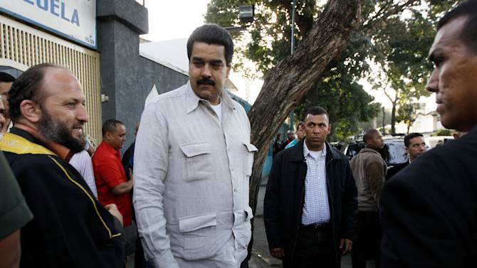 Venezuela's Vice President Nicolas Maduro, center,  walks with members of Venezuela's Islamic community after their meeting in Caracas, Venezuela, Friday, Dec. 14, 2012.  The most influential allies of Venezuela's President Hugo Chavez are projecting an image of unity while he recovers from cancer surgery in Cuba. Maduro was tapped by the 58-year-old president over the weekend as his chosen political heir, considered to be a member of radical left wing of Chavez's movement that is closely aligned with Cuba's communist government. (AP Photo/Fernando Llano)