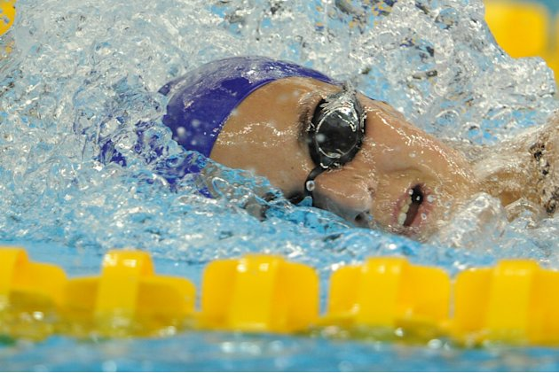 Britain's Keri-Anne Payne competes in the heats of the women's 1,500-metre freestyle swimming event in the FINA World Championships at the indoor stadium of the Oriental Sports Center in Shang