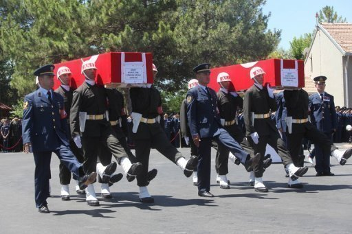 Turkish soldiers carry the coffins of two pilots - Air Force Captain Gokhan Ertan and Air Force Lieutenant Hasan Huseyin Aksoy - at their funeral ceremony in Malatya, Turkey on July 6. Turkey said it has found no traces of explosives on the wreckage of the fighter jet it has claimed was downed by Syria, raising new questions about the incident that inflamed cross-border tensions