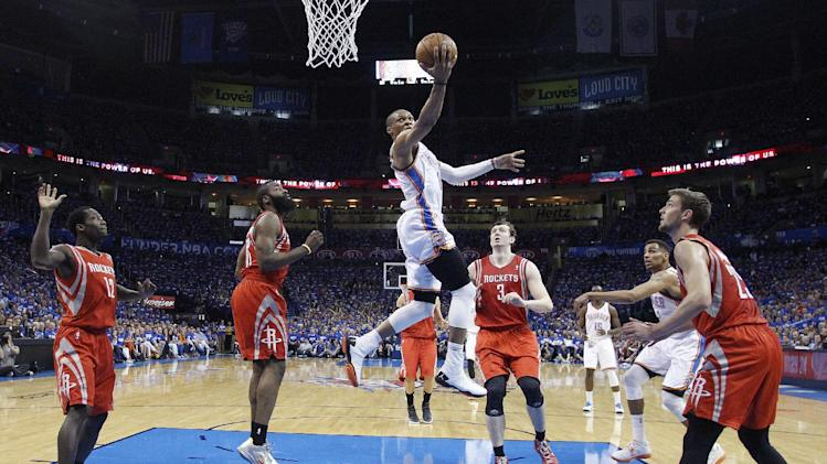 Oklahoma City Thunder guard Russell Westbrook (0) drives the lane against the Houston Rockets in the first quarter of Game 1 of their first-round NBA basketball playoff series in Oklahoma City, Sunday, April 21, 2013. (AP Photo/Sue Ogrocki)