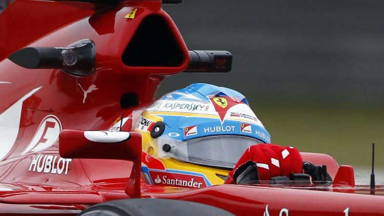 Ferrari Formula One driver Fernando Alonso of Spain drives during the first practice session of the Chinese F1 Grand Prix at the Shanghai International circuit