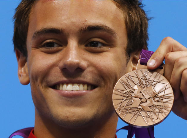 Britain's Tom Daley poses with his bronze medal during the men's 10m platform victory ceremony at the London 2012 Olympic Games at the Aquatics Centre