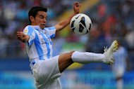 Malaga's Javier Saviola controls the ball during their Spanish La Liga match against Valladolid, at the Rosaleda stadium in Malaga, on October 20. Malaga travel to Espanyol next, on Saturday