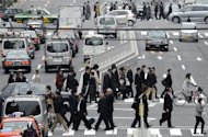 <p>This file photo shows pedestians crossing a street in downtown Tokyo, in 2011. Japanese manufacturers are increasingly nervous, a major business survey showed on Monday, as sagging demand at home and abroad is compounded by fears over the effects of a nasty territorial spat with China.</p>