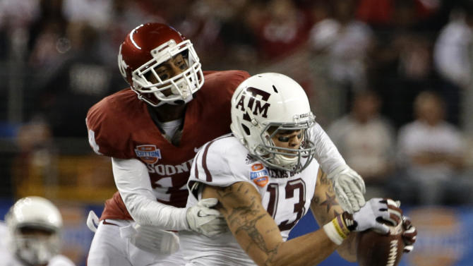Oklahoma defensive back Aaron Colvin can't stop a reception by Texas A&M's Mike Evans (13) during the second half of the Cotton Bowl NCAA college football game Friday, Jan. 4, 2013, in Arlington, Texas. (AP Photo/Tony Gutierrez)