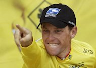 American Lance Armstrong celebrating on the podium after winning the 15th stage of the 90th Tour de France on July 21, 2009. A US insurance firm on Thursday filed a lawsuit against disgraced cyclist Lance Armstrong seeking restitution of $12 million in bonus money paid to the American for his Tour de France triumphs