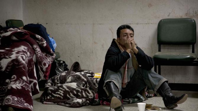 A relative of an injured person sits on the floor of a public hospital in the town of San Marcos, northern Guatemala, Wednesday, Nov. 7, 2012.  A 7.4 magnitude earthquake caused dozens of dead and many missing Wednesday in San Marcos, some 80 miles (130 kilometers) from the epicenter.(AP Photo/Moises Castillo)