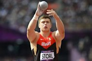 Germany&#39;s David Storl competes in the men&#39;s shot put qualifying rounds at the athletics event during the London 2012 Olympic Games. British poster-girl Jessica Ennis made a flying start to the heptathlon as the London Games athletics programme got under way in front of a vocal, 80,000-capacity Olympic Stadium crowd