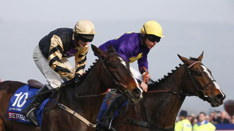 Davy Russell on Lord Windermere just beats David Casey on On His Own into second place in The Gold Cup at the Cheltenham Festival horse racing meet in Gloucestershire