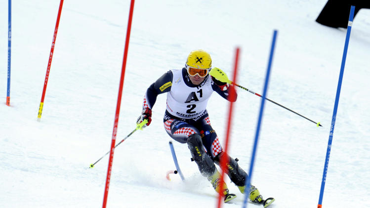 Croatia's Ivica Kostelic competes on his way to take third place, during an alpine ski, men's World Cup slalom in Kitzbuehel, Austria, Sunday, Jan. 27, 2013. (AP Photo/Giovanni Auletta)