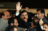 Pakistan&#39;s former prime minister Yousuf Raza Gilani (C) is seen outside the Supreme Court building in Islamabad in April 2012. Gilani was dismissed for refusing to reopen corruption cases against President Asif Ali Zardari. His son, Abdul Qadir Gilani, won a by-election on Thursday in the family constituency in the central town of Multan