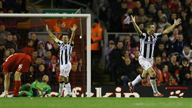 Udinese's Giovanni Pasquale (R) celebrates scoring against Liverpool during their Europa League Group A match at Anfield in Liverpool October 4, 2012.