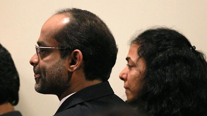 Dharun Ravi's parents Ravi Pazhani, left, and Sabitha Ravi listen to the guilty verdict  on Friday, March 16, 2012 at the Middlesex Superior Court in New Brunswick, N.J.  Ravi, a former Rutgers University student accused of using a webcam to spy on his gay roommate's love life has been convicted of bias intimidation and invasion of privacy. A jury found that he used a webcam to spy on roommate Tyler Clementi.  Within days, Clementi realized he had been watched and jumped to his death from New York's George Washington Bridge in September 2010.   (AP Photo/The Star-Ledger, Jerry McCrea, Pool)