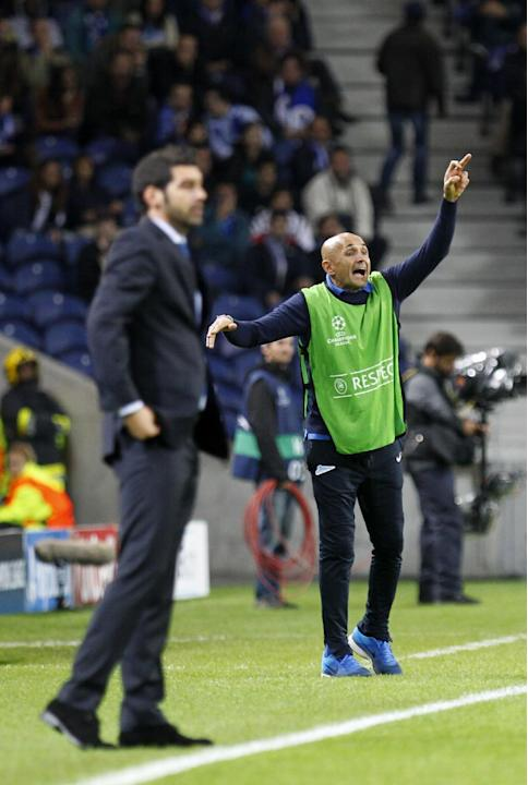 Zenit's coach Luciano Spalletti, right, from Italy, shouts instructions as Porto's coach Paulo Fonseca, left, watches the action during the Champions League group G soccer match between FC Porto and Z