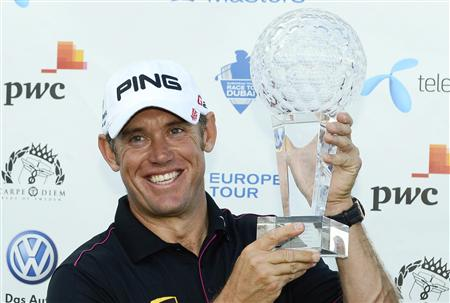 Westwood smiles while holding the trophy after winning the Nordea Masters golf tournament at the Bro Hof golf club