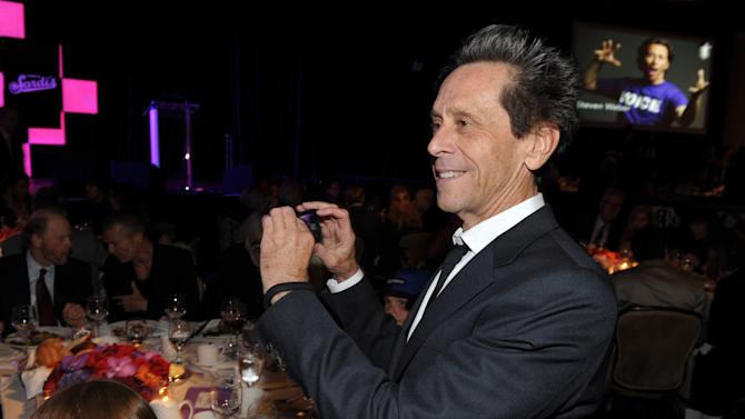 Producer Brian Grazer takes a photo in the audience at the 21st Annual 'A Night at Sardi's' to benefit the Alzheimer's Association at the Beverly Hilton Hotel on March 20, 2013 in Beverly Hills, Calif. (Photo by John Shearer/Invision for Alzheimer's Association/AP Images)