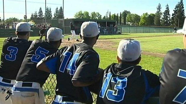 Baseball team rushes to save trapped girl's life