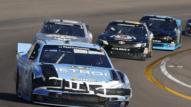 Sam Hornish Jr. (12) takes his damaged car into Turn 4 during the NASCAR Nationwide Series auto race Saturday, March 2, 2013, in Avondale, Ariz. (AP Photo/Ross D. Franklin)