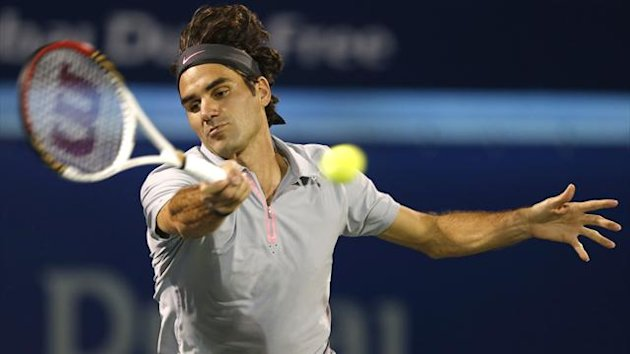 Roger Federer in action in Dubai (Reuters)