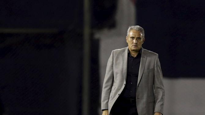 Head coach of Brazil's Corinthians Tite gives instructions to his players against  Paraguay's Guarani during their Copa Libertadores soccer match at the Defensores del Chaco stadium in Asuncion