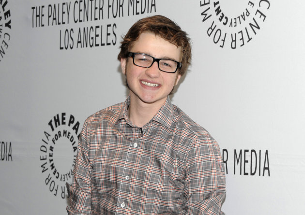 FILE - In this March 12, 2012 file photo, actor Angus T. Jones arrives at the Paleyfest panel discussion of the television series &quot;Two and a Half Men&quot; in Beverly Hills, Calif. Jones, the teenage actor who plays the half in the hit CBS comedy &quot;Two and a Half Men&quot; says it&#39;s &quot;filth&quot; and through a video posted by a Christian church has urged viewers not to watch it. (AP Photo/Dan Steinberg, File)