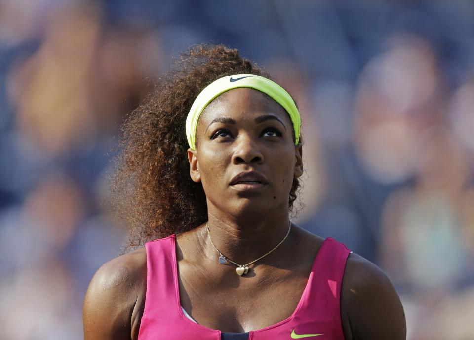 Serena Williams looks into the stands during her match against Spain's Maria Jose Martinez Sanchez in the second round of play at the 2012 US Open tennis tournament,  Thursday, Aug. 30, 2012, in New York. (AP Photo/Darron Cummings)