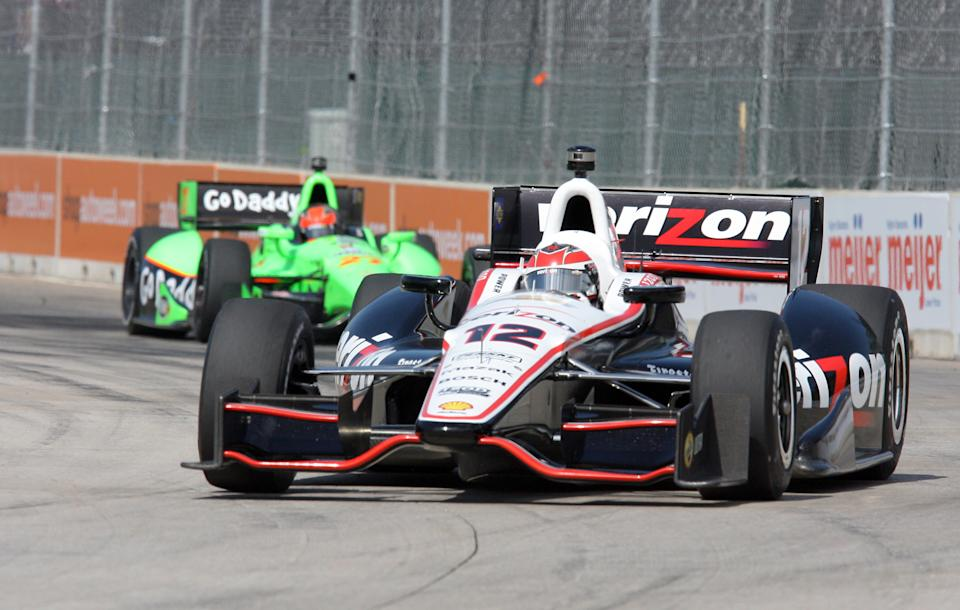 IndyCar driver Will Power practices on the track for the Detroit Grand Prix auto race on Belle Isle in Detroit, Sunday, June 3, 2012. (AP Photo/Dave Frechette)