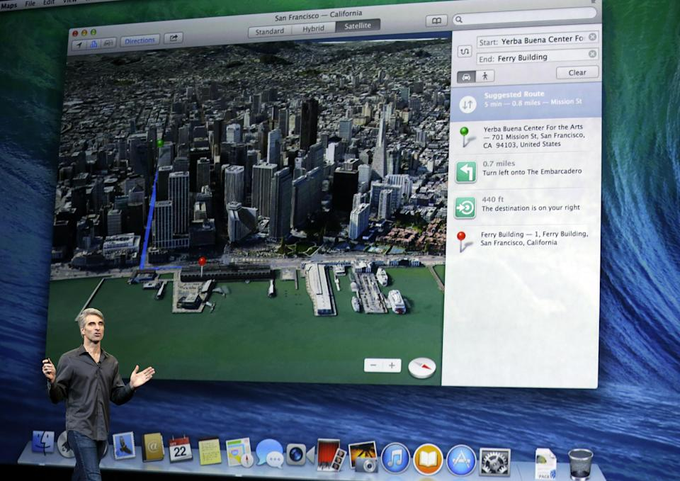 Craig Federighi, senior vice president of Software Engineering at Apple, speaks on stage before a new product announcement on Tuesday, Oct. 22, 2013, in San Francisco. (AP Photo/Marcio Jose Sanchez)