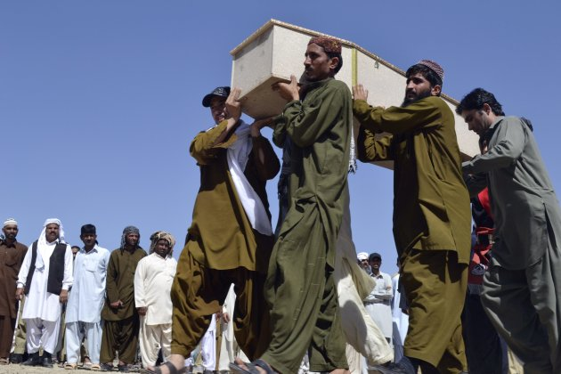Relatives carry the casket of a victim, who was killed in a bomb blast, for the funeral in Quetta