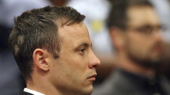 Oscar Pistorius sits  in court in Pretoria, South Africa, Tuesday, Oct. 21, 2014. Pistorius will finally learn his fate  when judge Thokozile Masipais is expected to announce the Olympic runner's sentence for killing girlfriend Reeva Steenkamp  (AP Photo/Themba Hadebe, Pool)