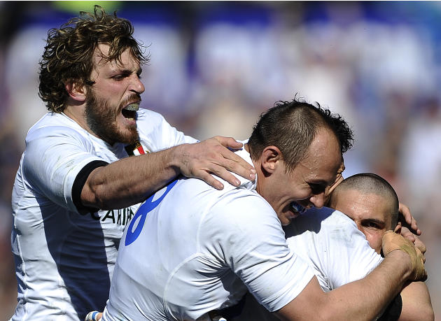 Italy's Giovanbattista Venditti (C) celebrates with teammates after scoring against Scotland during their Rugby Union Six Nations match at the Rome's Olympic stadium on March 17, 2012. Italy defeated